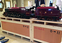 train ready for packing in large wooden transport case