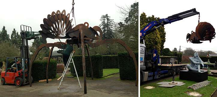 loading a large sculpture into a wooden packing crate
