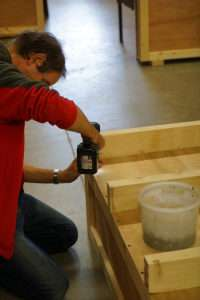 Fitting the base to a wooden crate