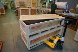 Two wooden shipping crates ready for loading onto a delivery vehicle