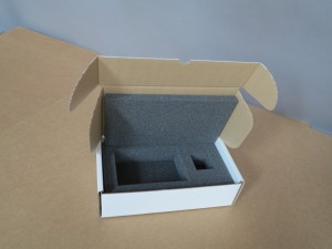 A cardboard box with foam insert