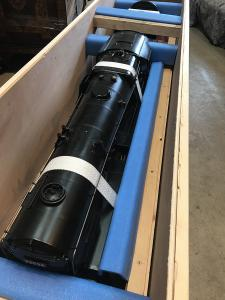 Antique train packed in wooden crate